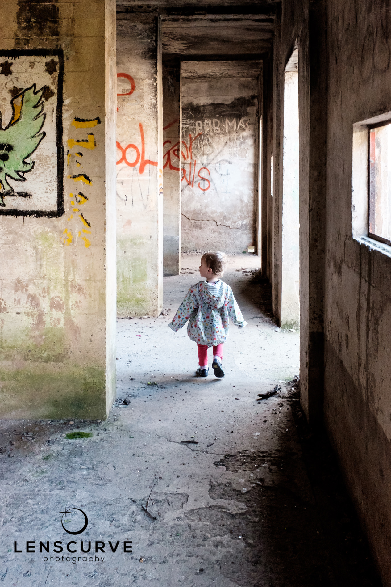 Toddler exploring an abandoned building