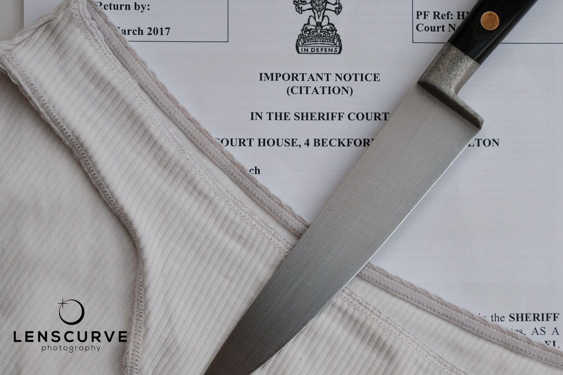 Photograph of Underpants, Knives and Court Citations Representing The Life of A Forensic Biologist