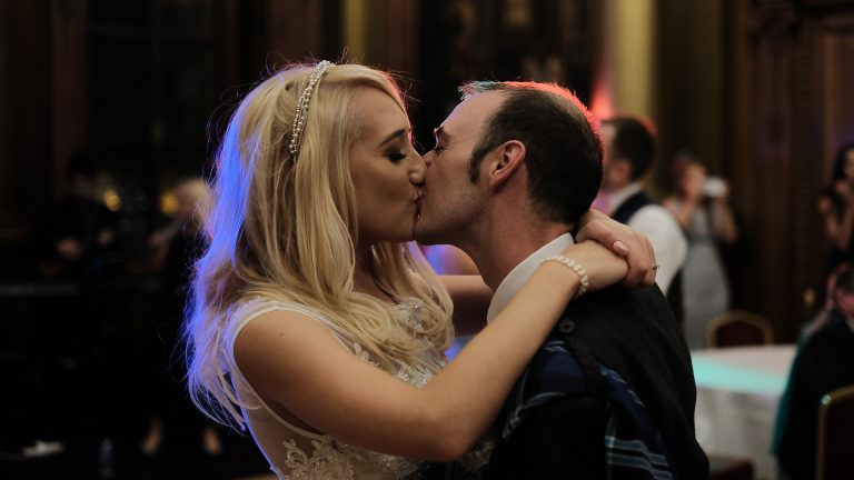 bride and groom kiss during their first dance during their wedding at Edinburgh City Chanbers
