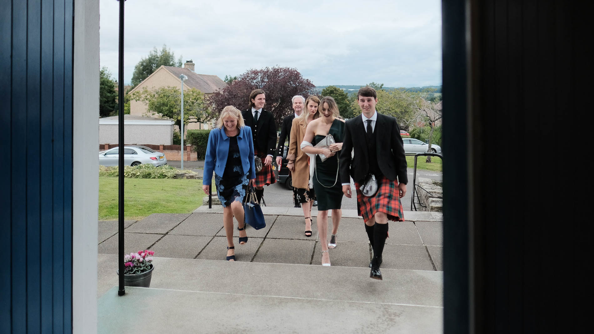 Colour photograph of guests arriving at a wedding at Saint Andrew's Church, Clermiston, Edinburgh