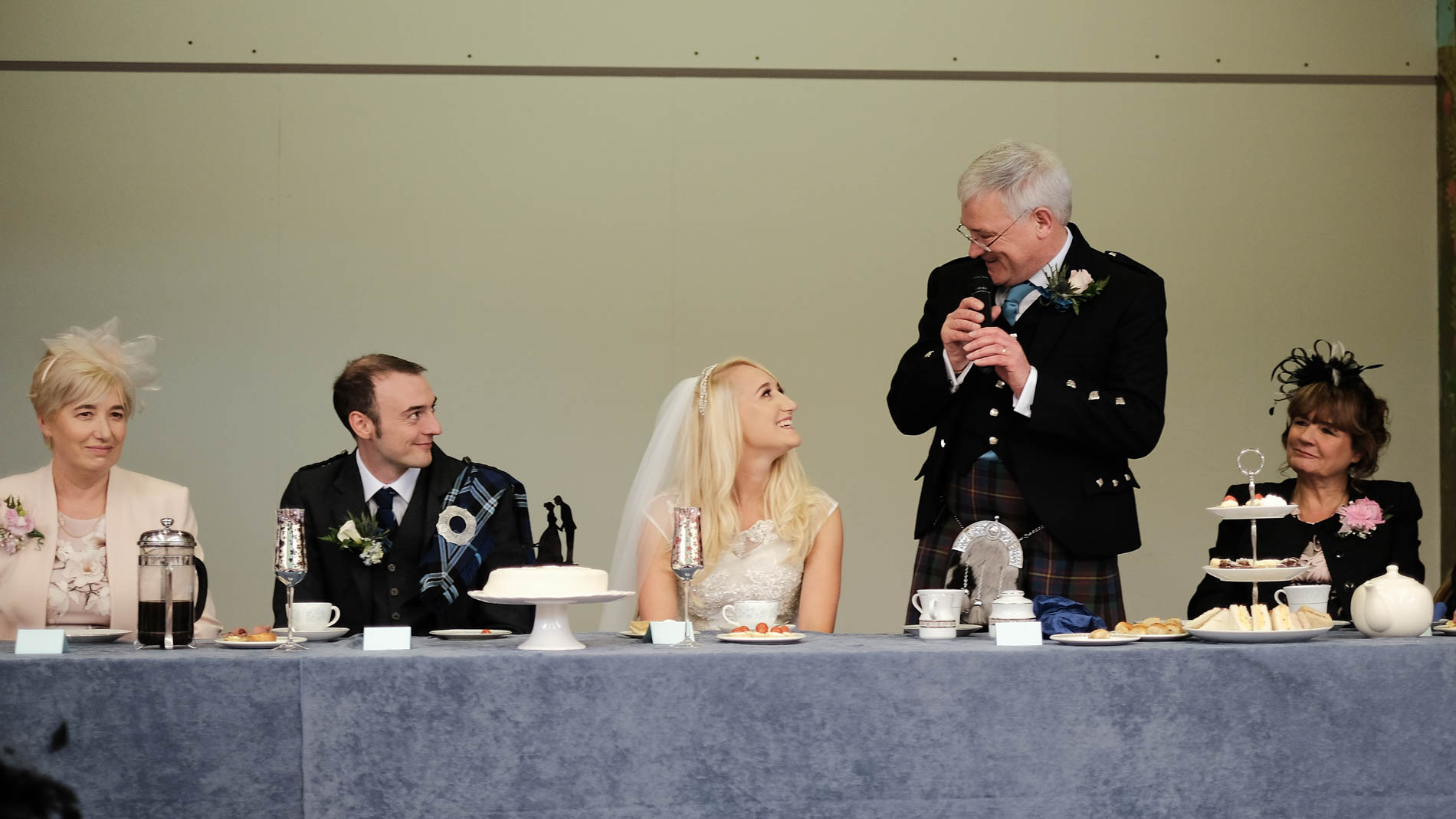 Colour photograph of the father of the bride giving a speech at Saint Andrew's Hall, Clermiston