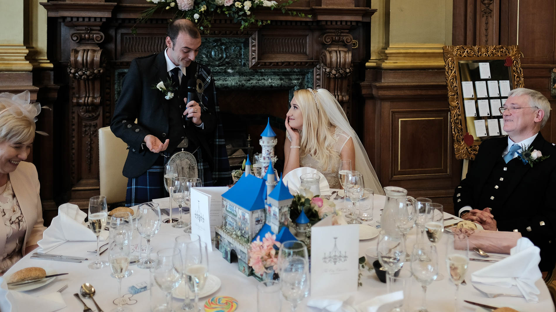 A colour photograph of the groom giving his speech during his wedding reception in Edinburgh City Chambers