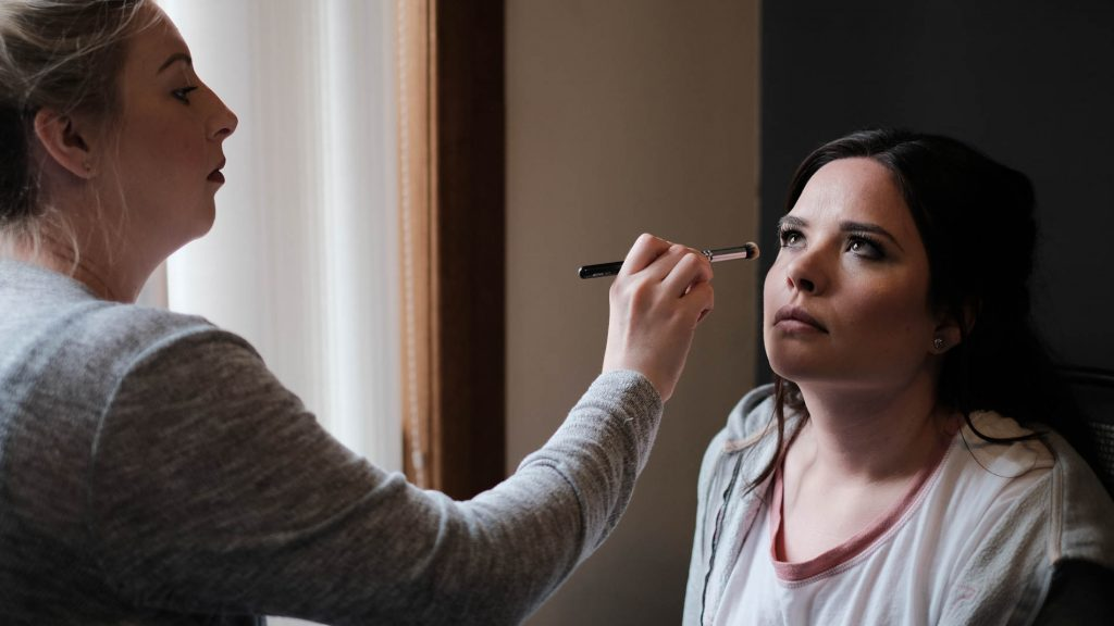 colour photograph of a bridesmaid getting ready for a wedding