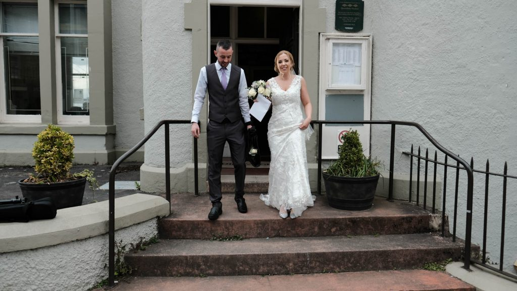 colour photograph of the bride and groom leaving South Queensferry Registrars Office