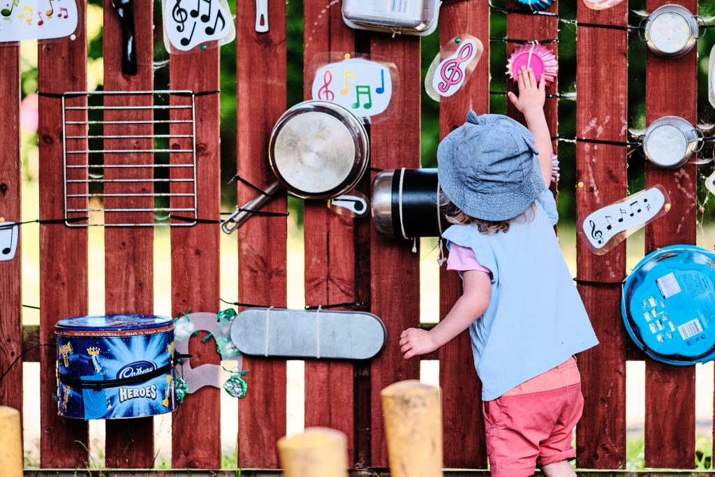 colour photograph of a toddler playing outside