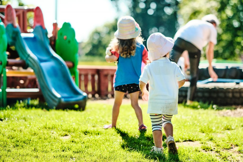 colour photograph of a children playing outside