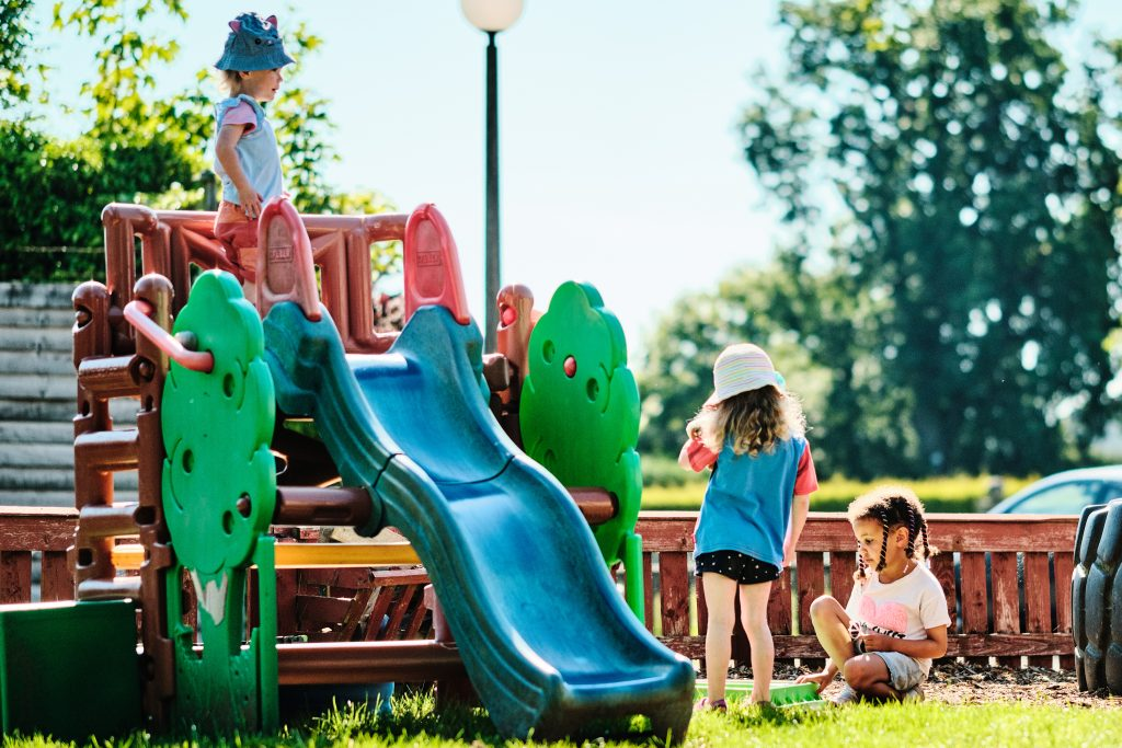 colour photograph of children playing on a slide