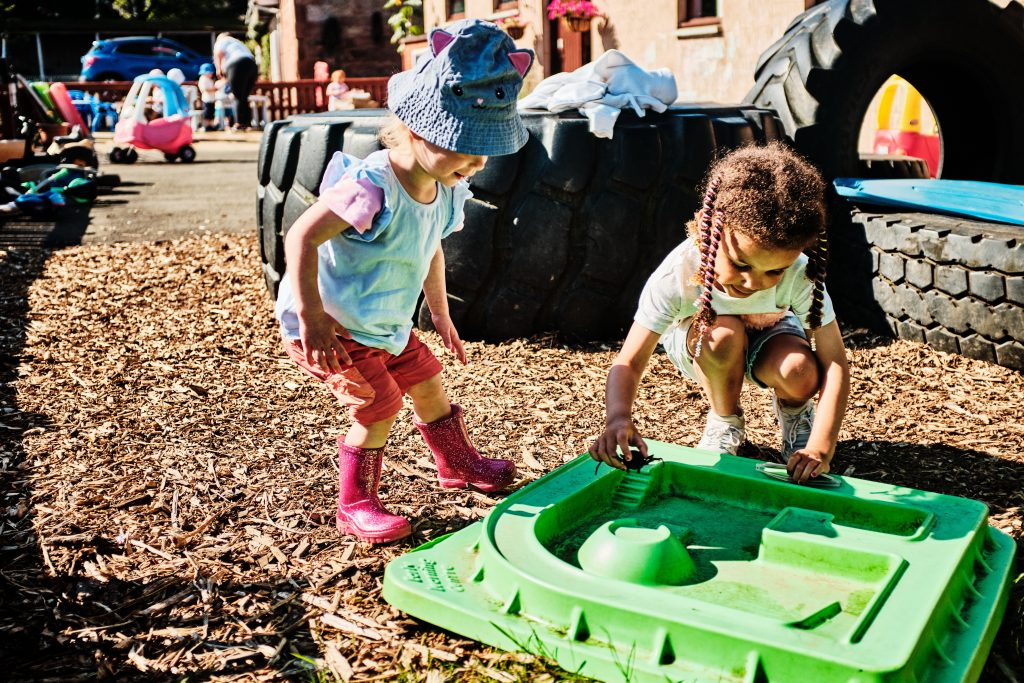 colour photograph of children playing in a sandpit