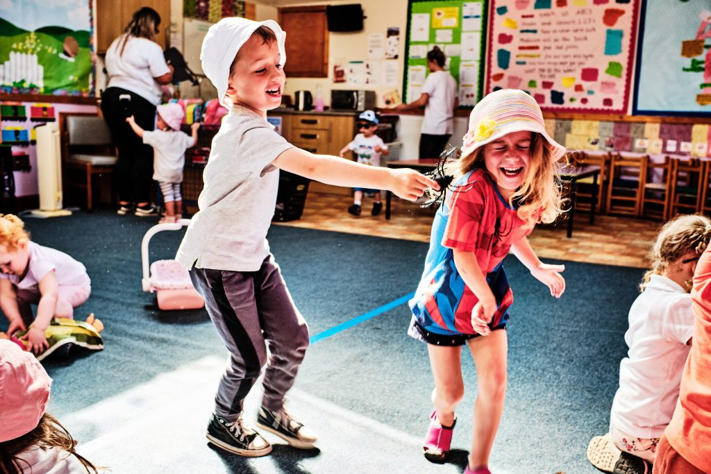 colour photograph of a boy and girl playing in a nursery school