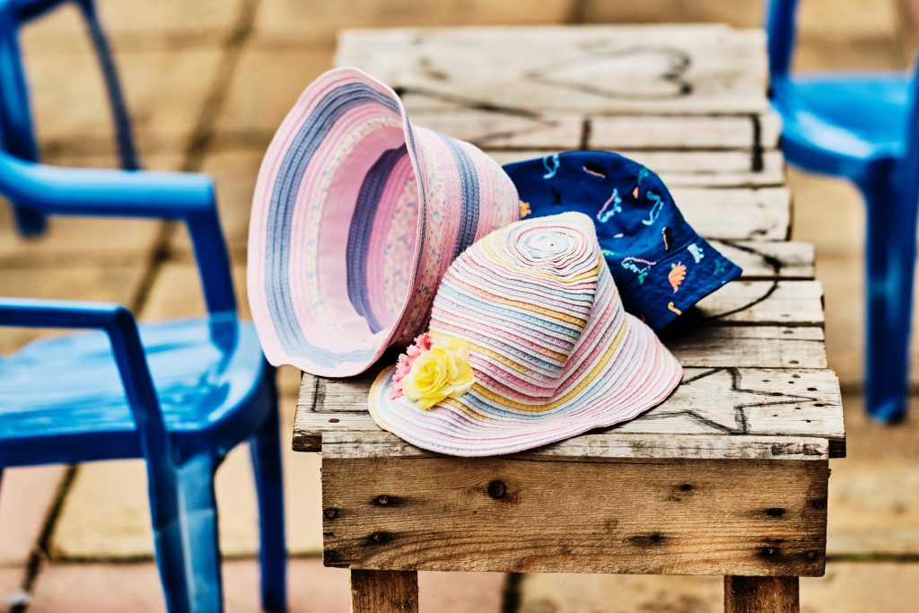 colour photograph of children's sun hats on a table