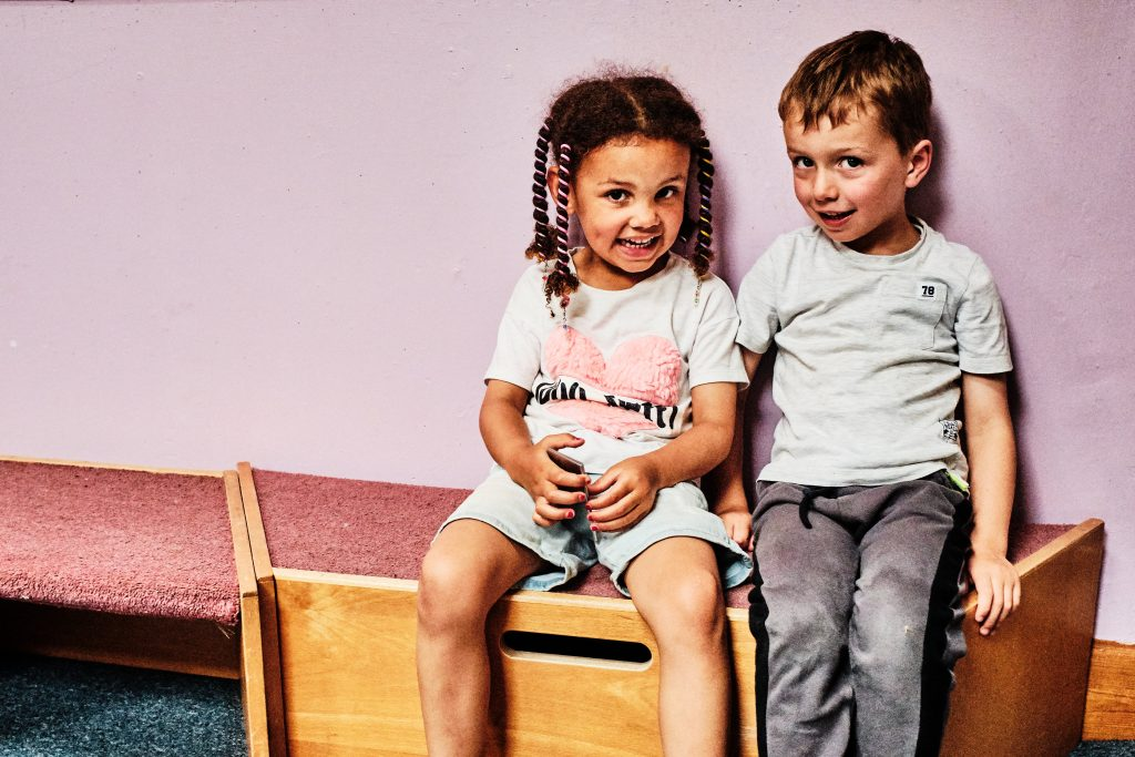 colour photograph of two children in nursery school