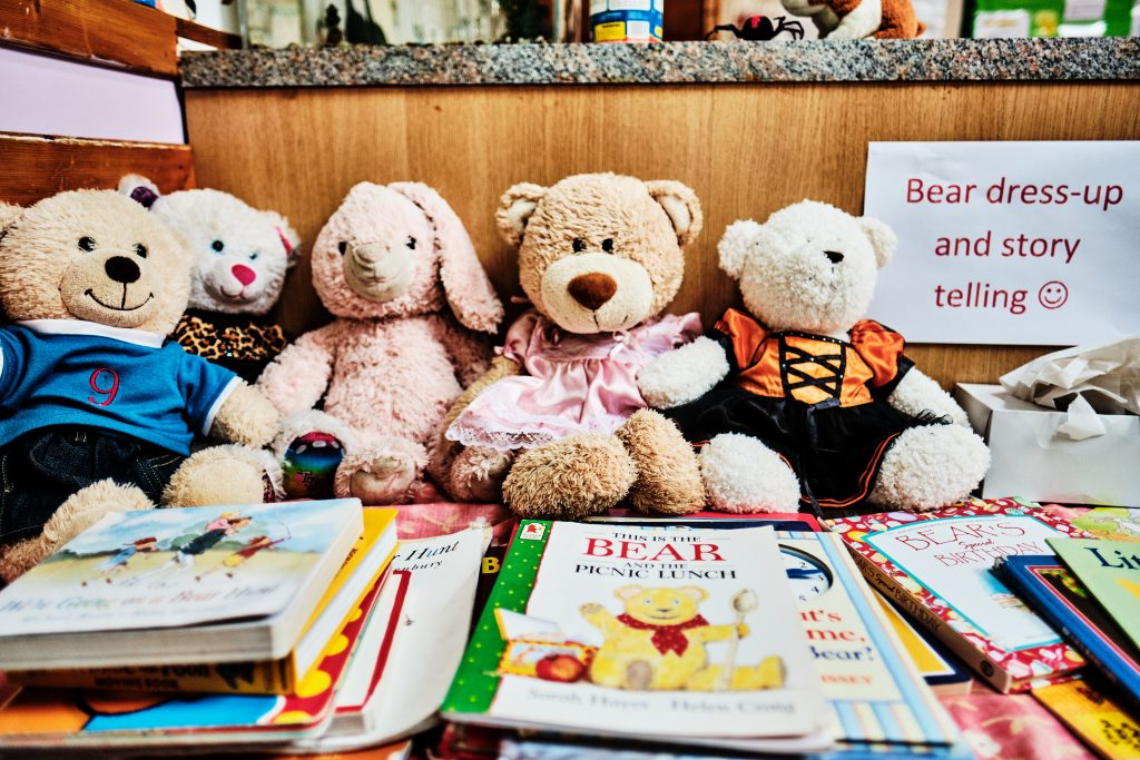 colour photograph of books and teddy bears