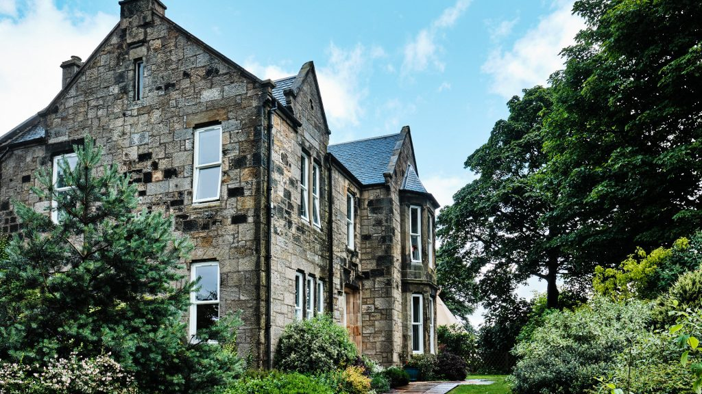 colour photograph of a large sandstone house in Fife, Scotland