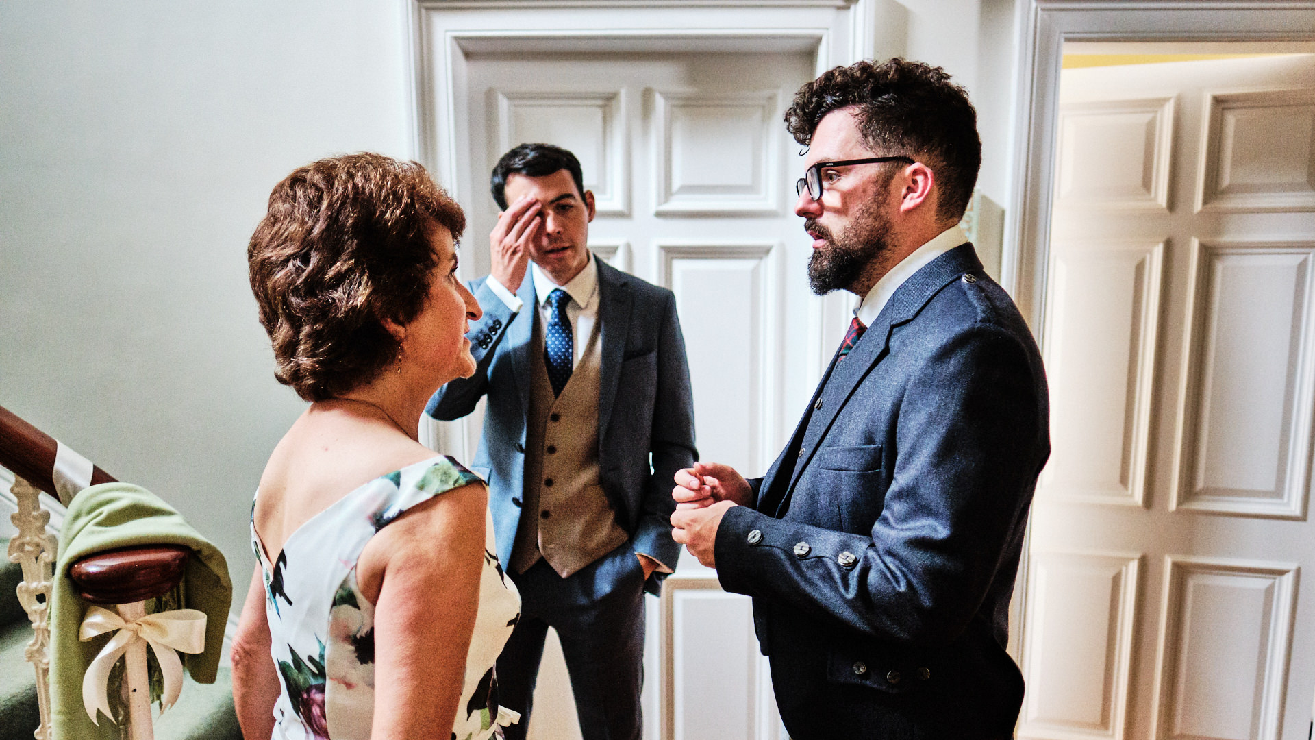colour photograph of a bride groom and his mother talking on the morning of his wedding day