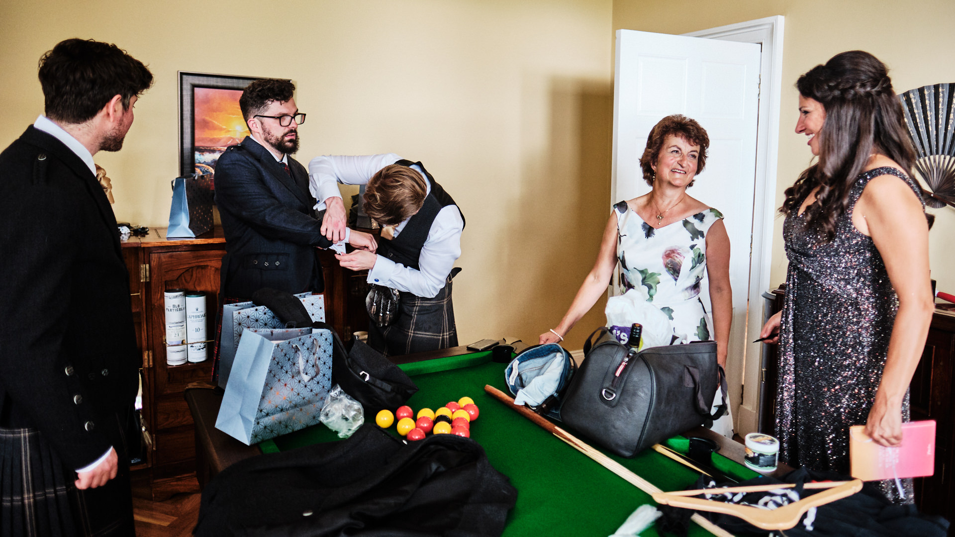 a colour photograph of the bridegroom and his family getting ready for the wedding