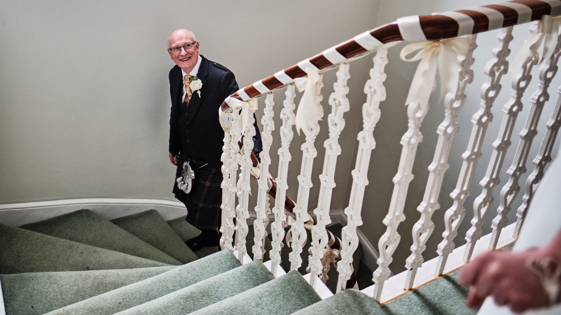 colour photograph of the father of the bride seeing his daughter in her wedding dress for the first time on her wedding day