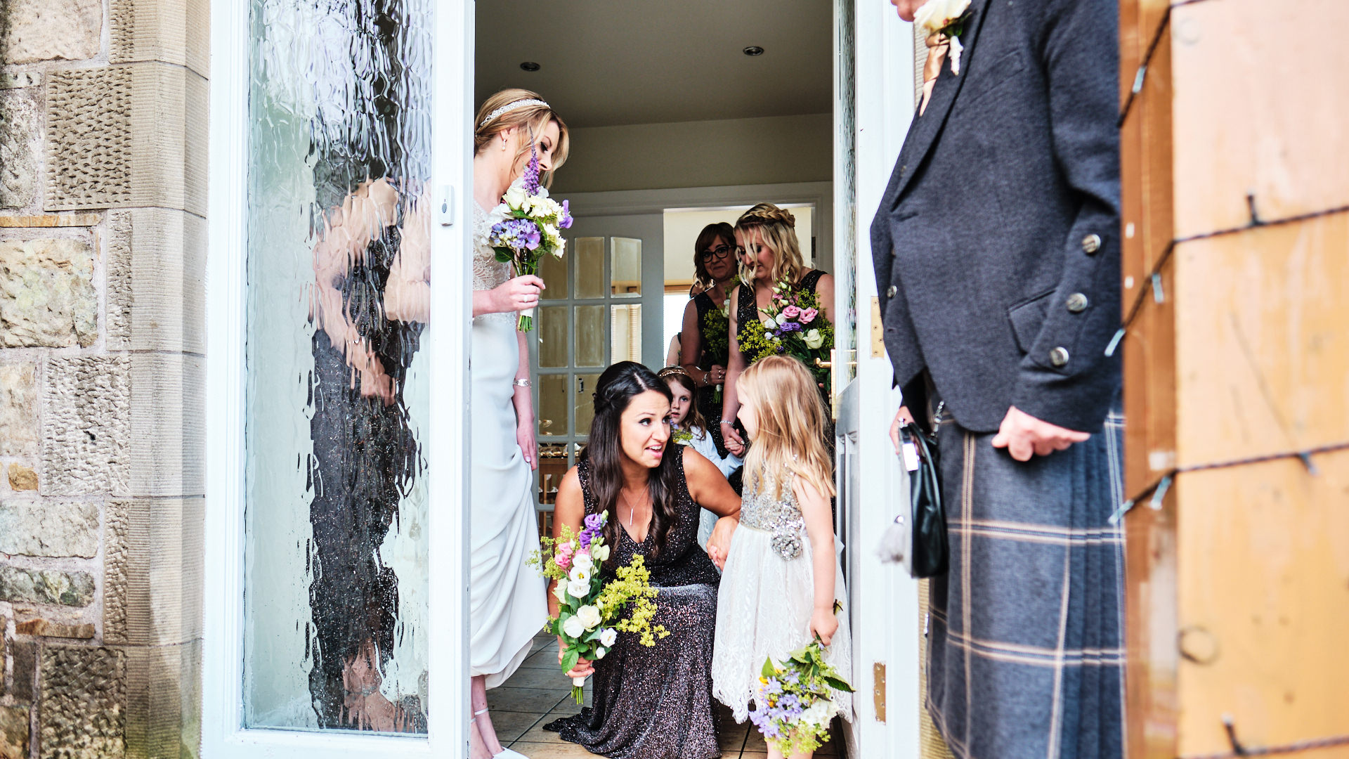 colour photograph of the bride and her bridal party getting ready to walk to the wedding ceremony being held at the bride's home