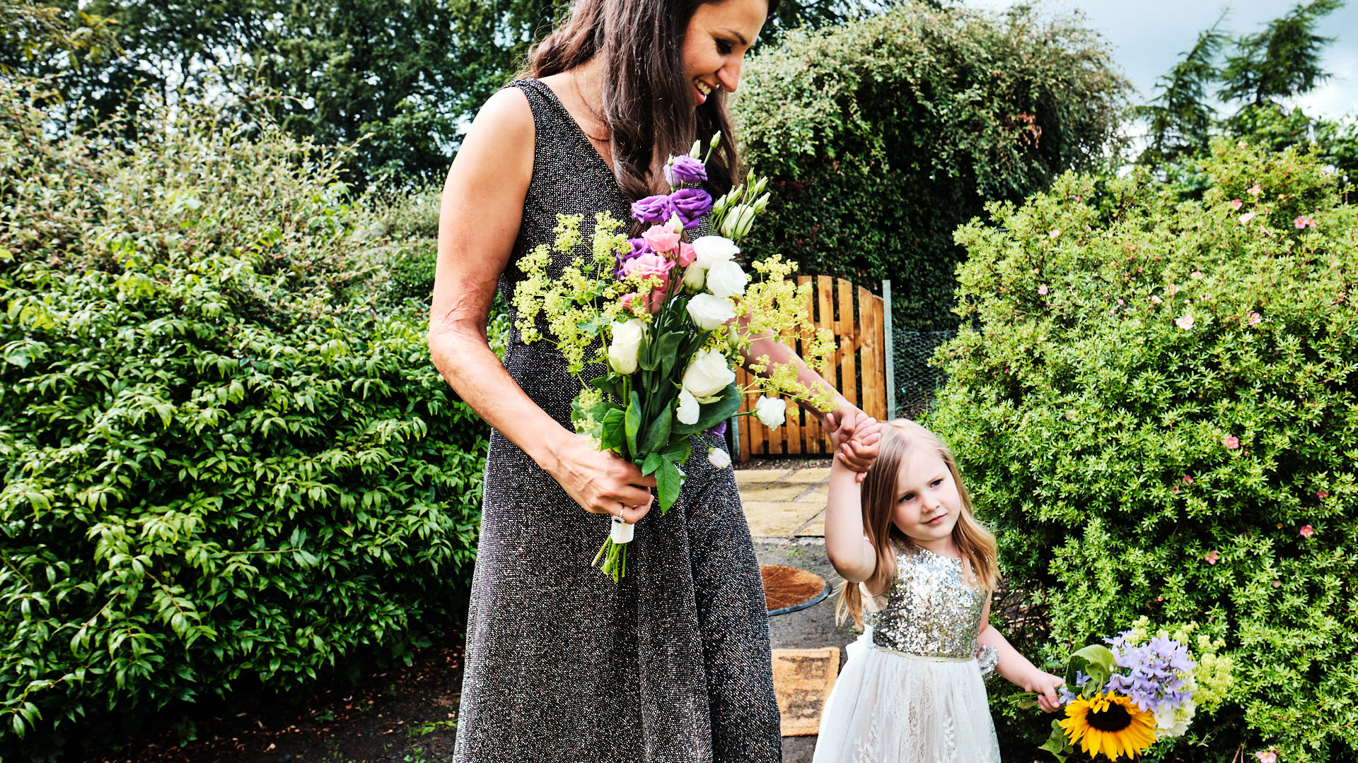 a colour photograph of the chief bridesmaid and a flower girl walking to a wedding ceremony