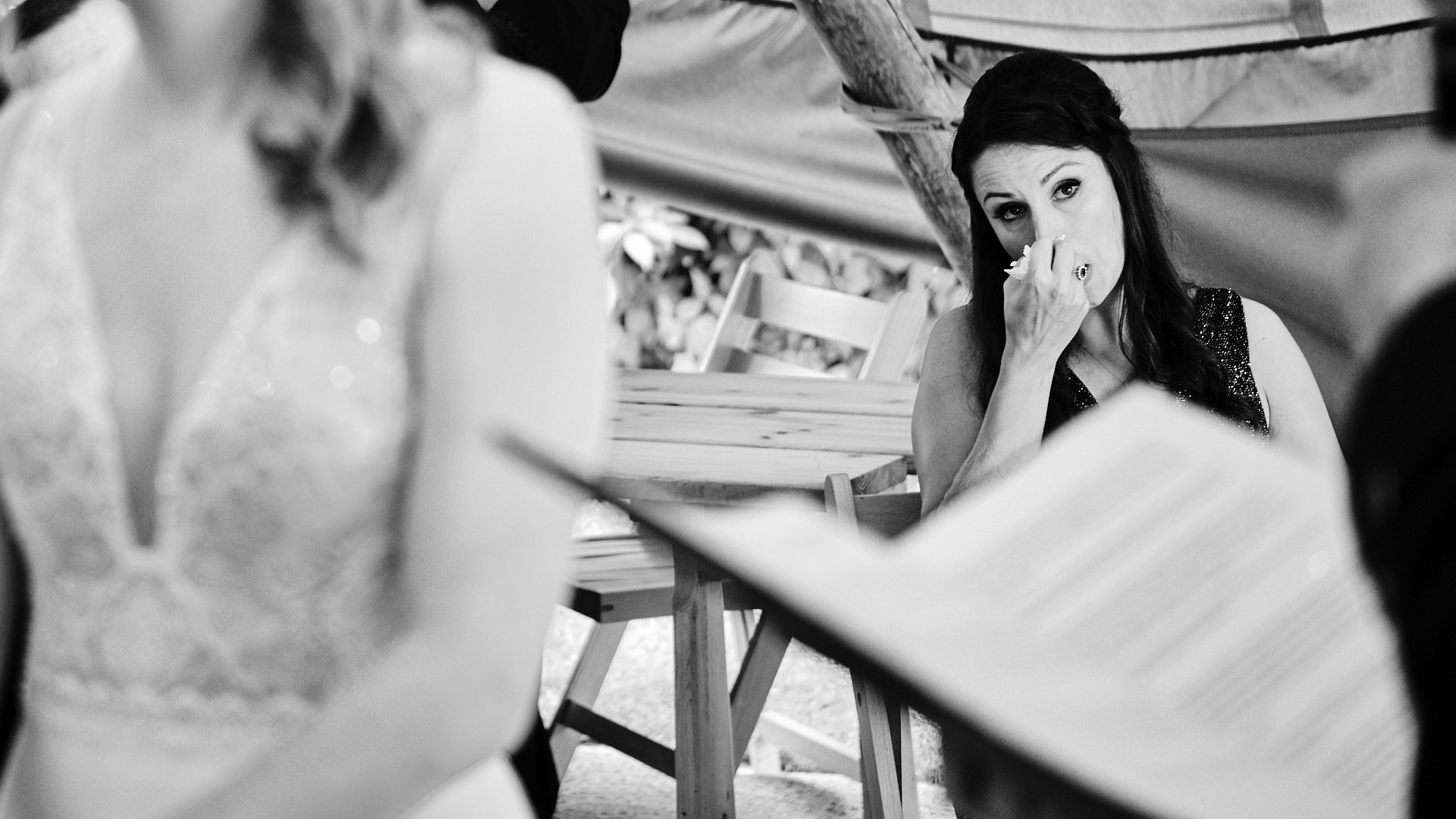 black and white photograph of a bridesmaid crying during a wedding ceremony