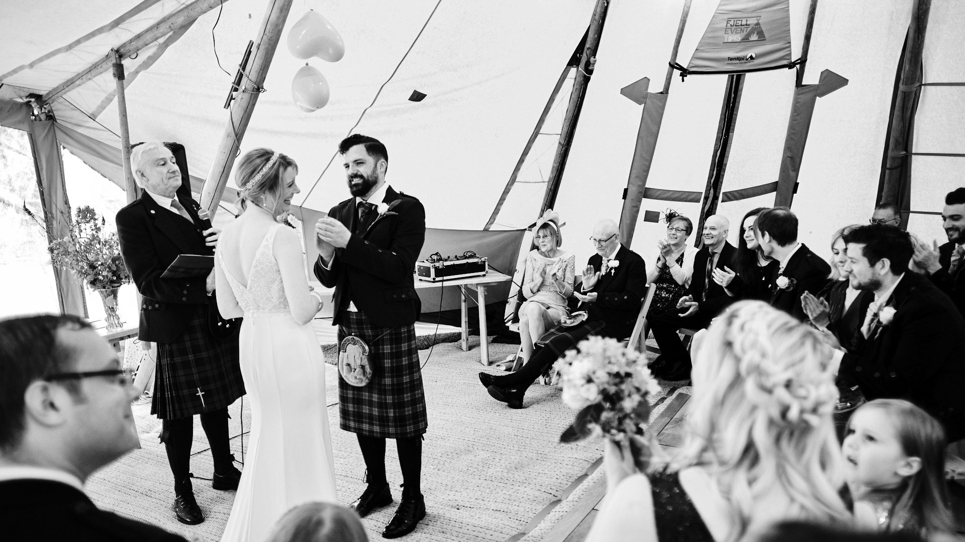 black and white photograph of the bride and groom during their wedding ceremony