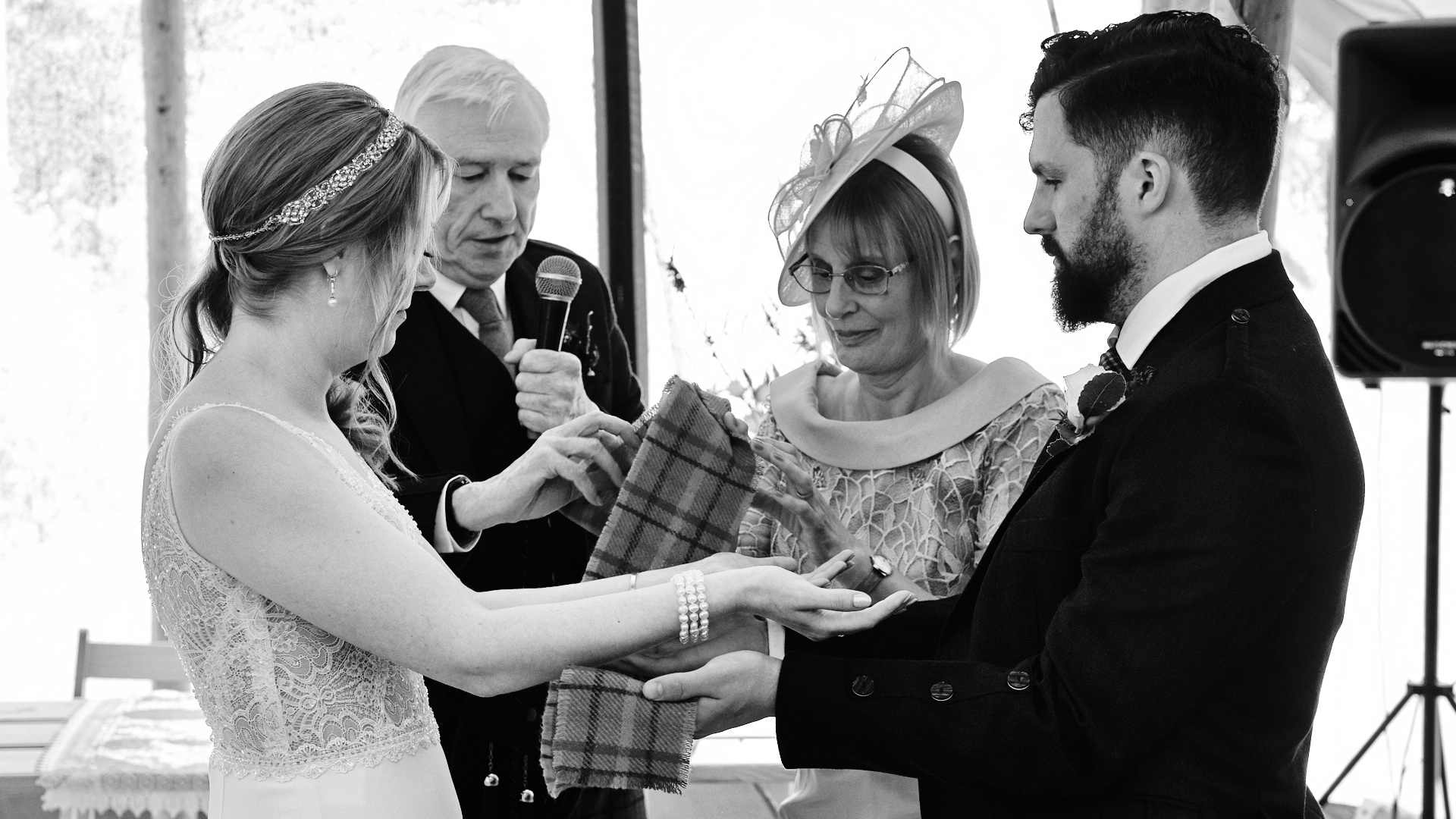 black and white photograph of a traditional Scottish hand fasting part off a wedding ceremony