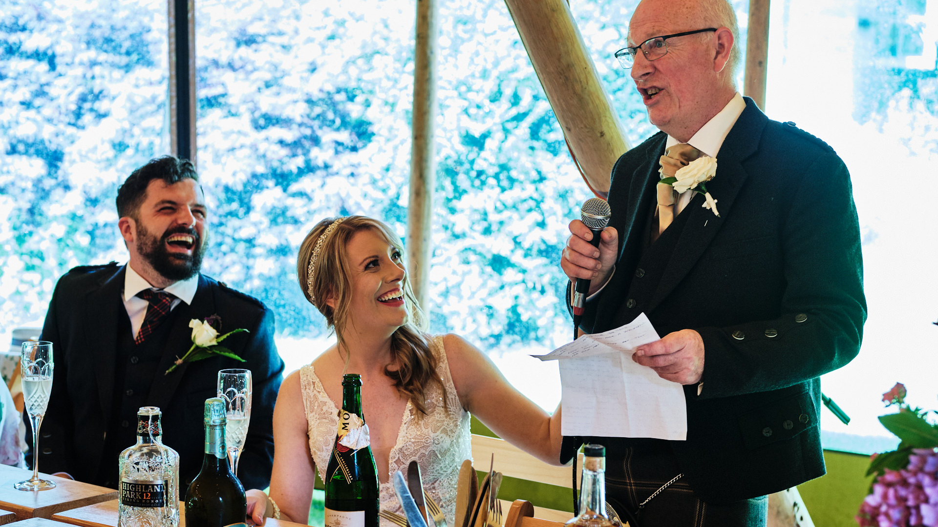 colour photograph of the father of the bride giving a speech at his daughter's wedding
