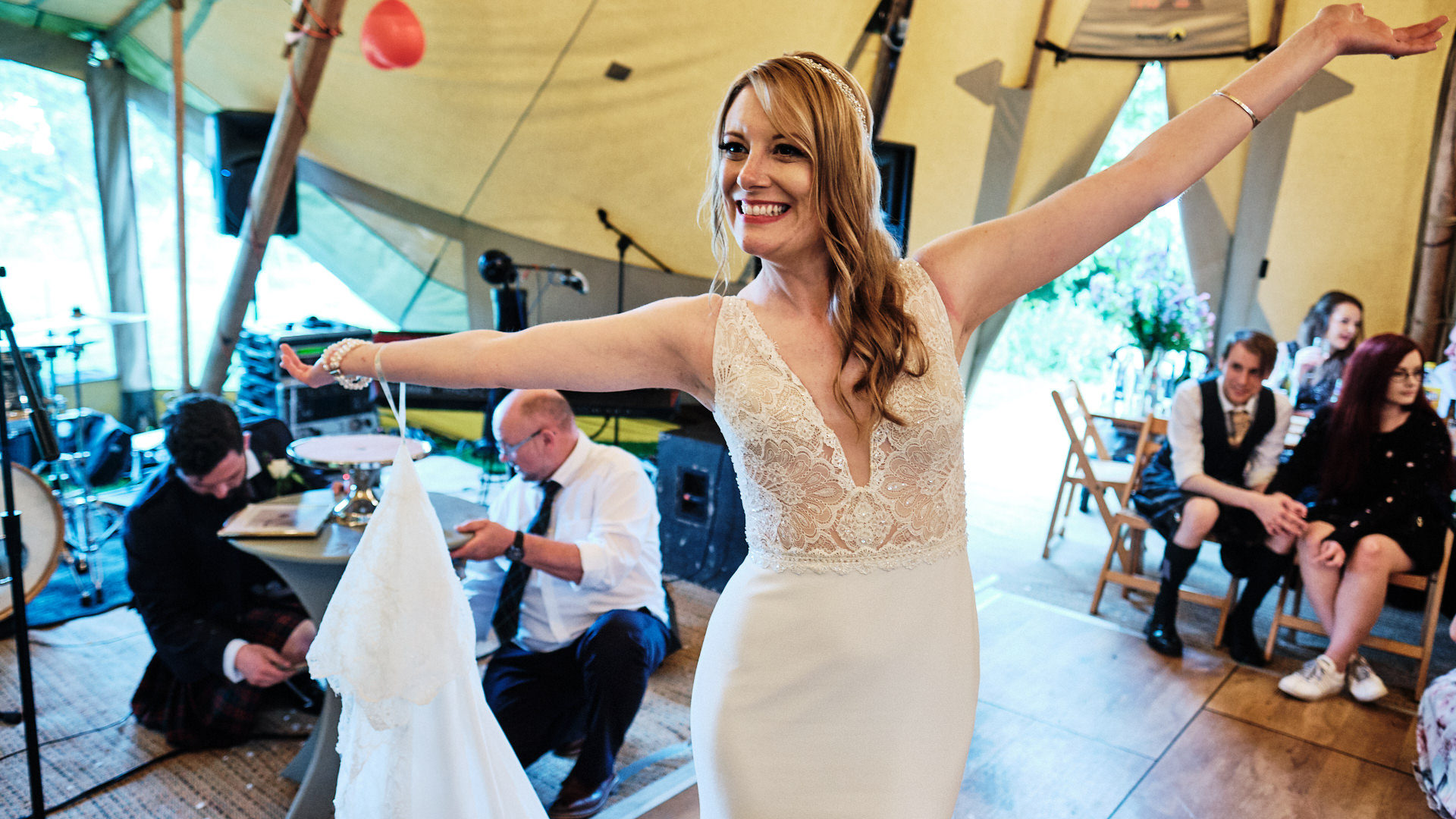 colour photograph of a smiling bride on the dance floor at her wedding reception