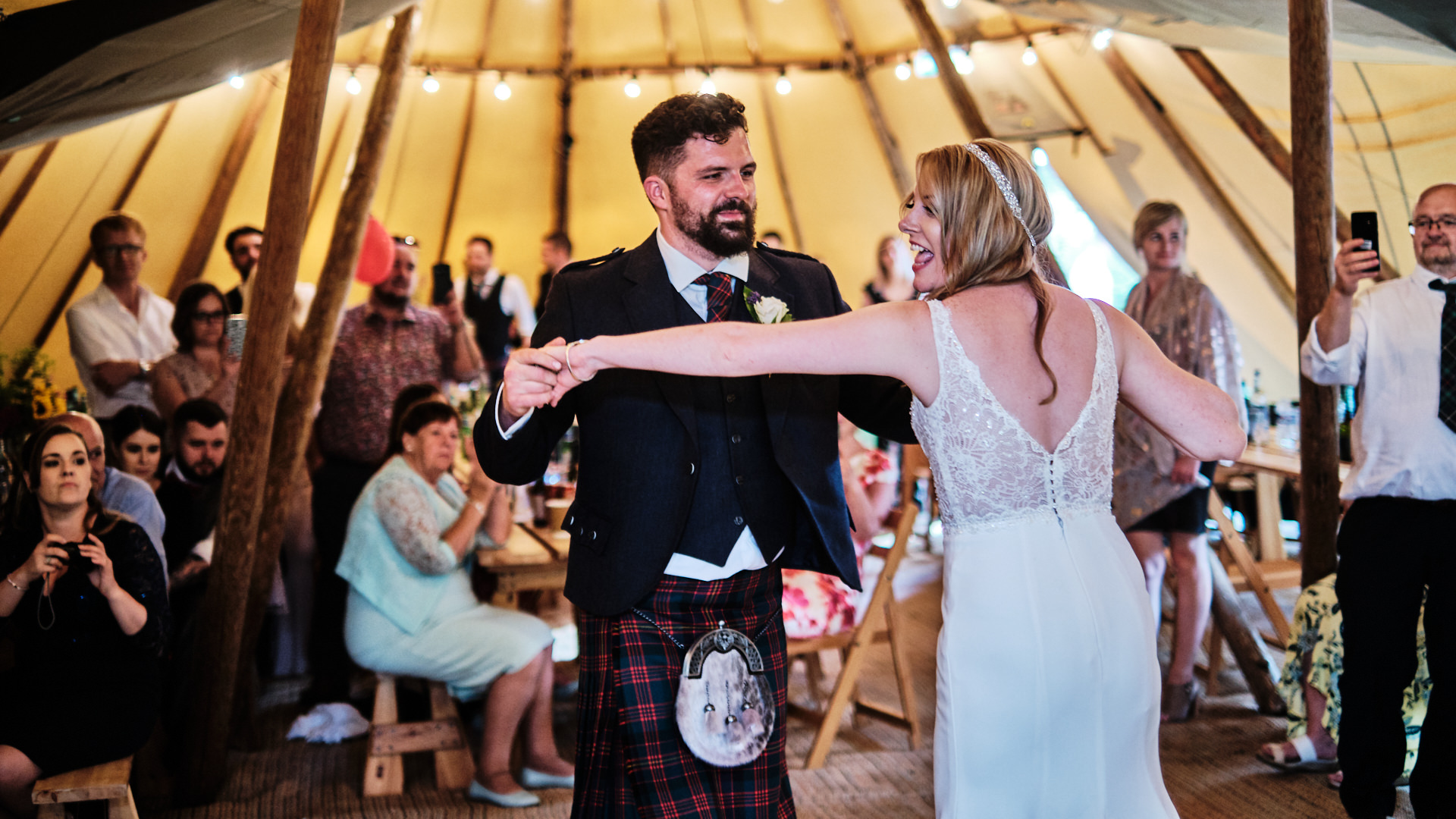 colour photograph of the bride and groom during their first dance at their wedding