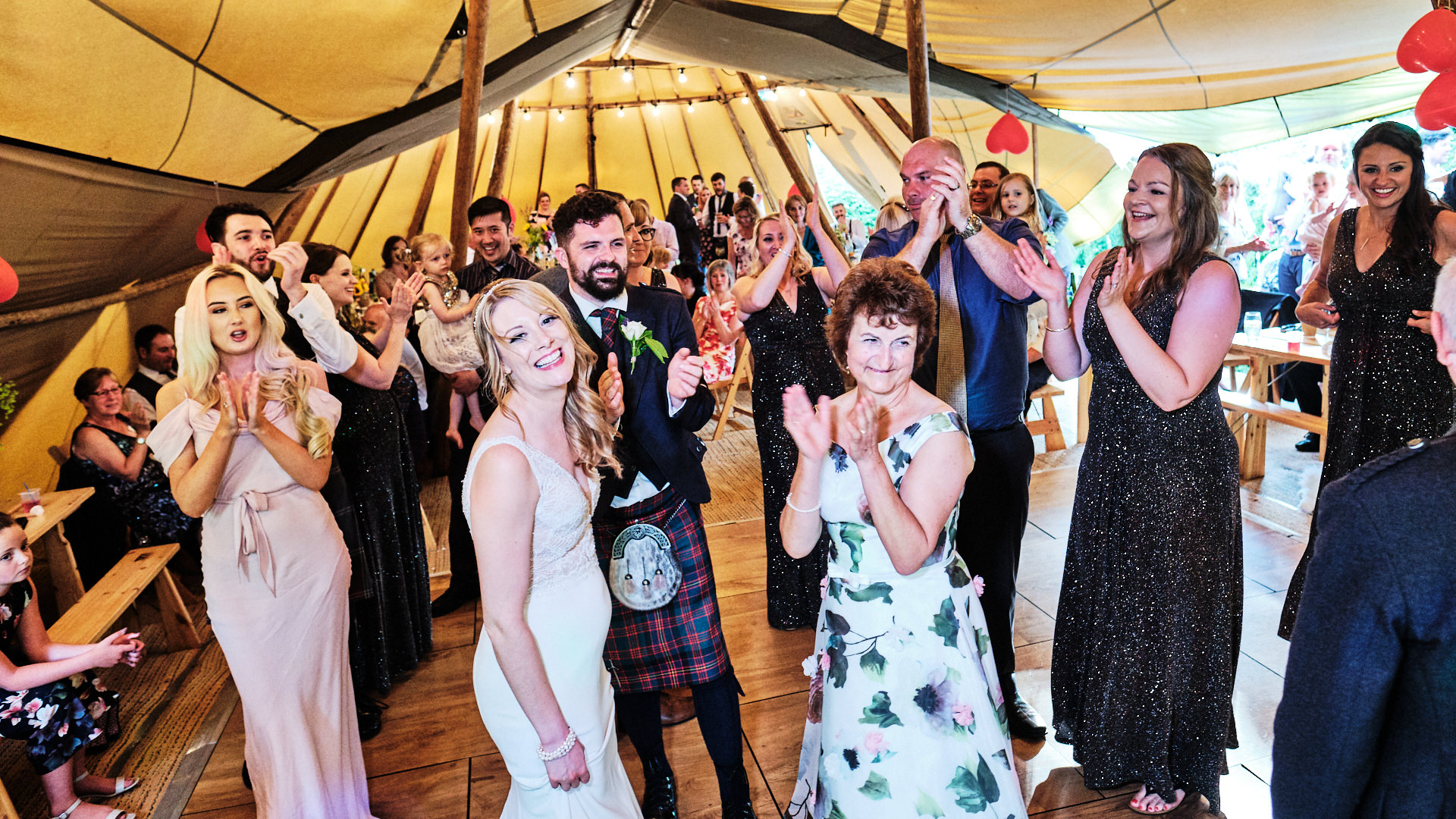 colour photograph of wedding guests clapping on the dance floor during the wedding reception