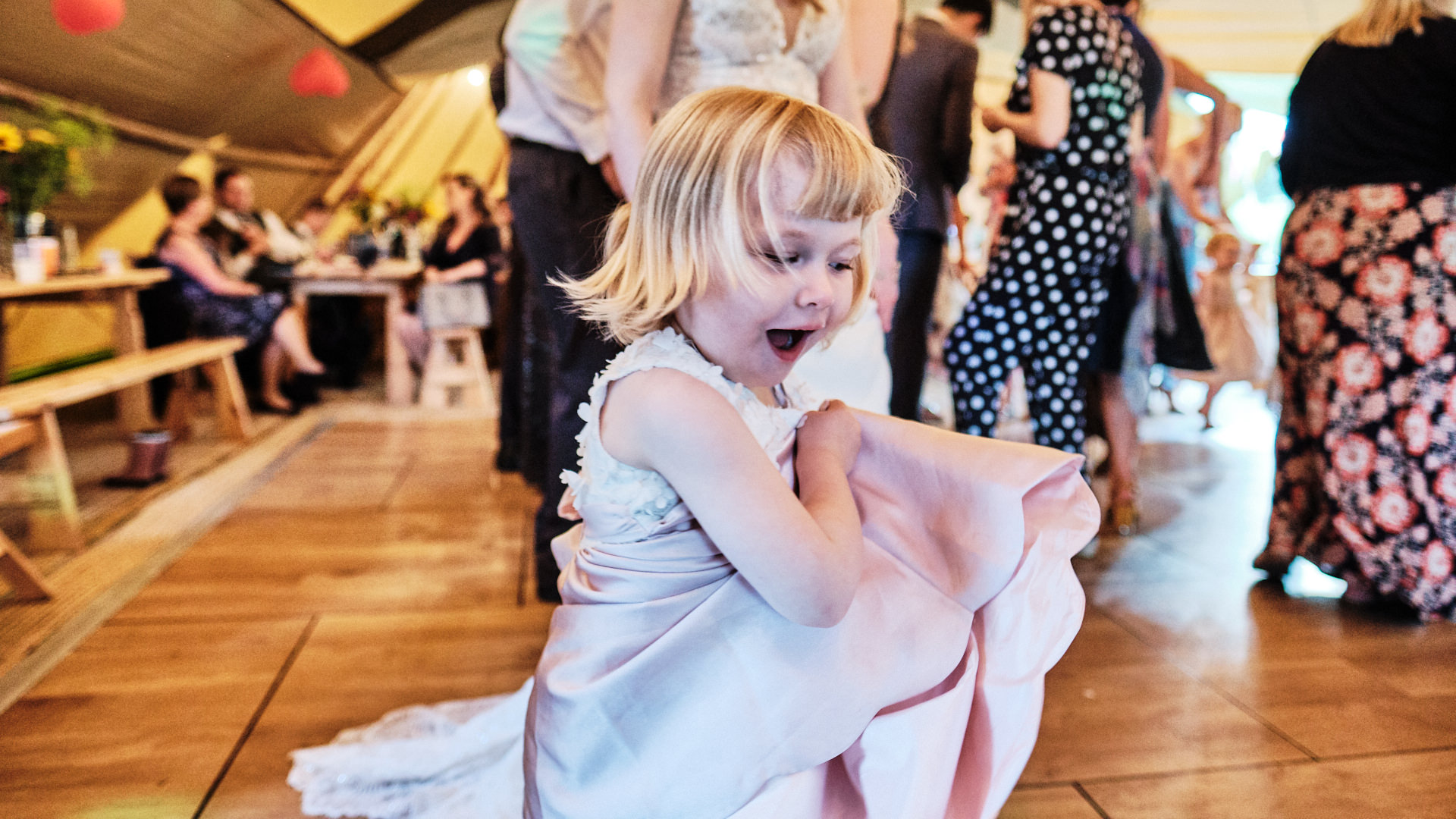 colour photograph of a young girls dancing on the dance floor during a wedding reception